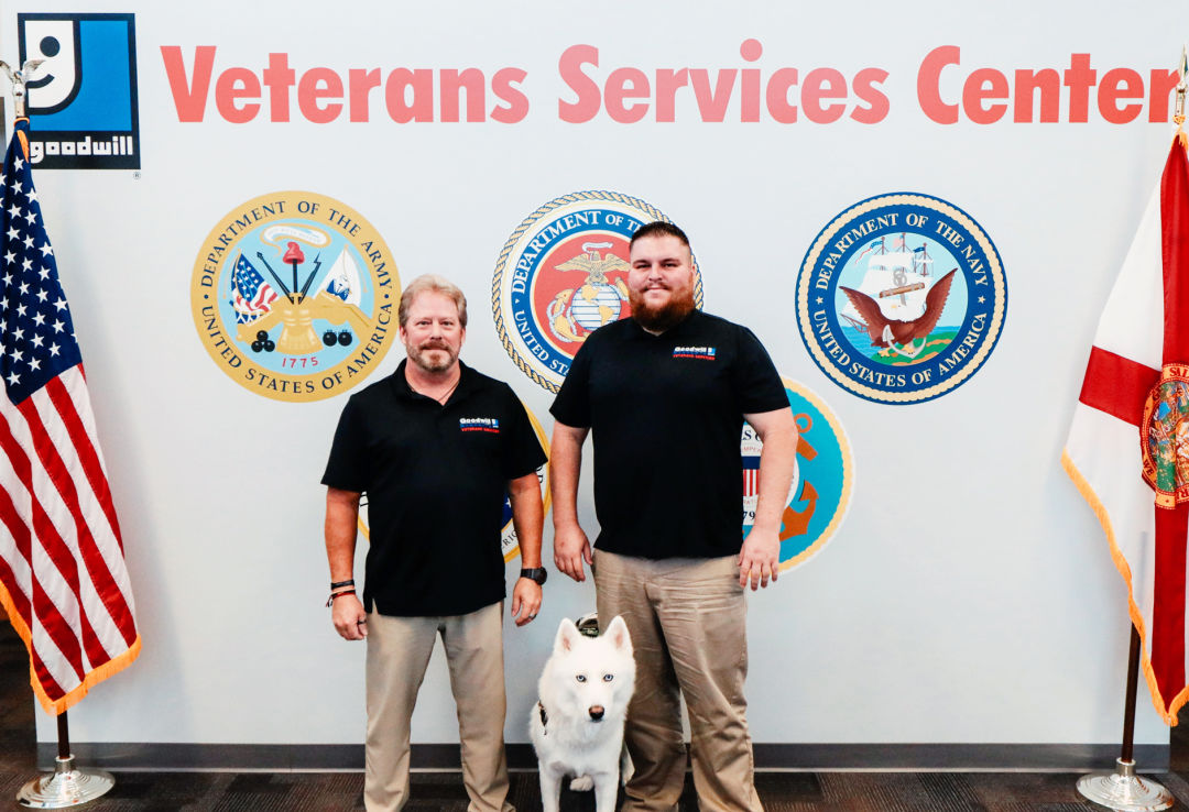 Veterans Services Program team member Randy Wright (left) and Todd Hughes, program manager, with service dog Ghost