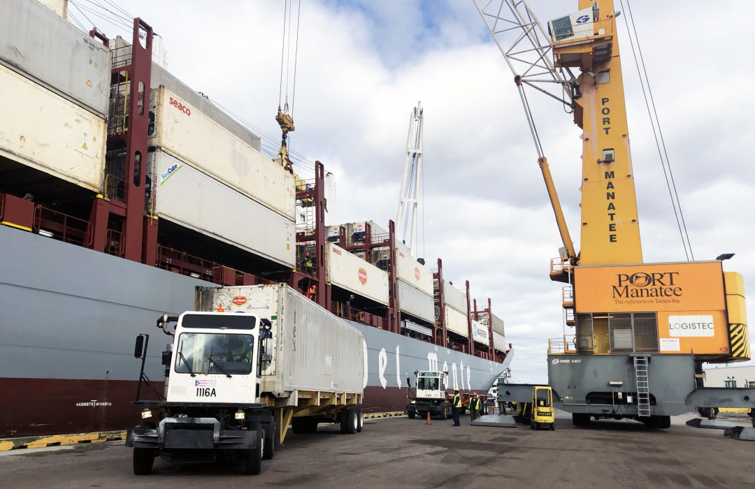 Containers are offloaded from Fresh Del Monte Produce Inc.'s Del Monte Spirit as the energy-efficient vessel makes its Jan. 9 inaugural call at Port Manatee.