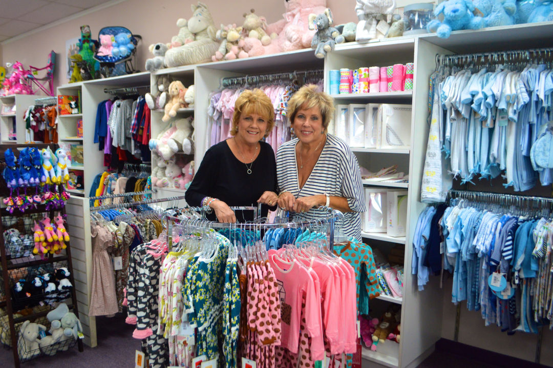 Sweet Bambini owners Pam Claiborne and Bonnie Palmer at their Memorial  boutique. b7321cf87