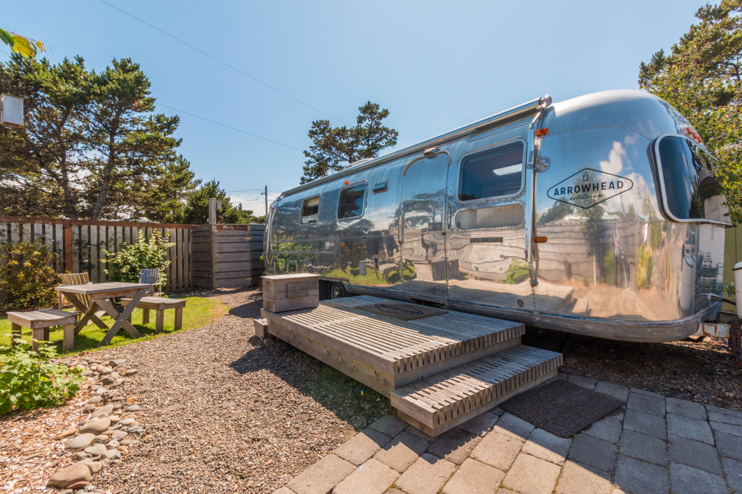 The Arrowhead, a 1971 Land Yacht Sovereign Airstream, is one of seven rentable trailers at Hart's Camp in Pacific City.