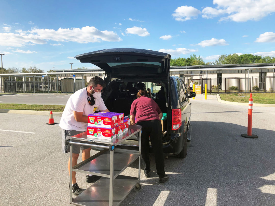 Volunteers from All Faiths Food Bank helped to distribute meals in advance of spring break; this distribution was held at Fruitville Elementary School