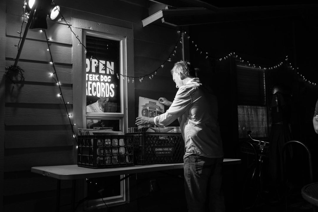 Doug Holland flips through the bins at Jerk Dog Records