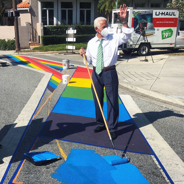 Rep. Charlie Crist contributes to the mural in downtown Sarasota