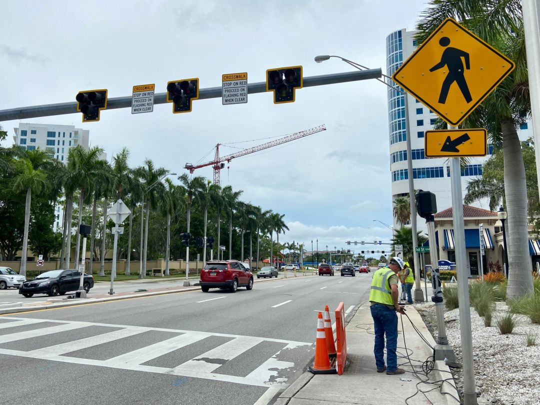 The signalized pedestrian crosswalk at US 41-First St. is now disconnected.