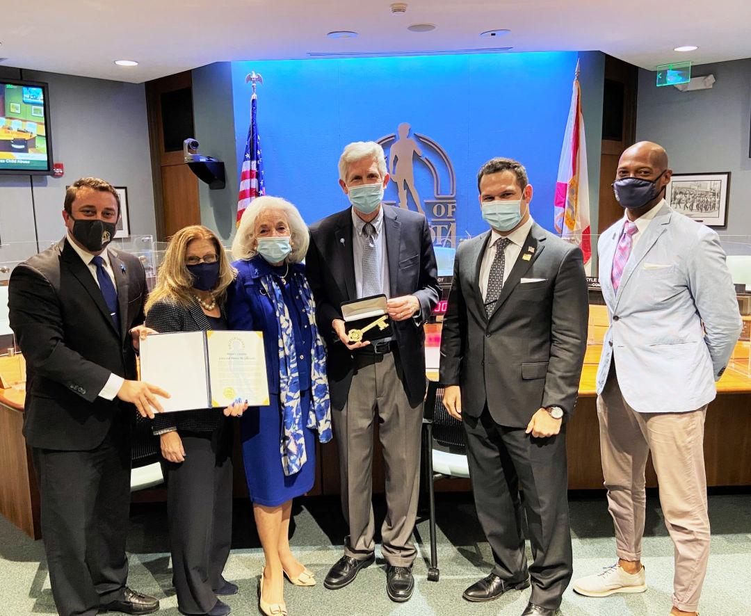 From left: Mayor Hagan Brody, Commissioner Liz Alpert, Graci McGillicuddy, Dennis McGillicuddy, Commissioner Erik J. Arroyo, Commissioner Kyle S. Battie.