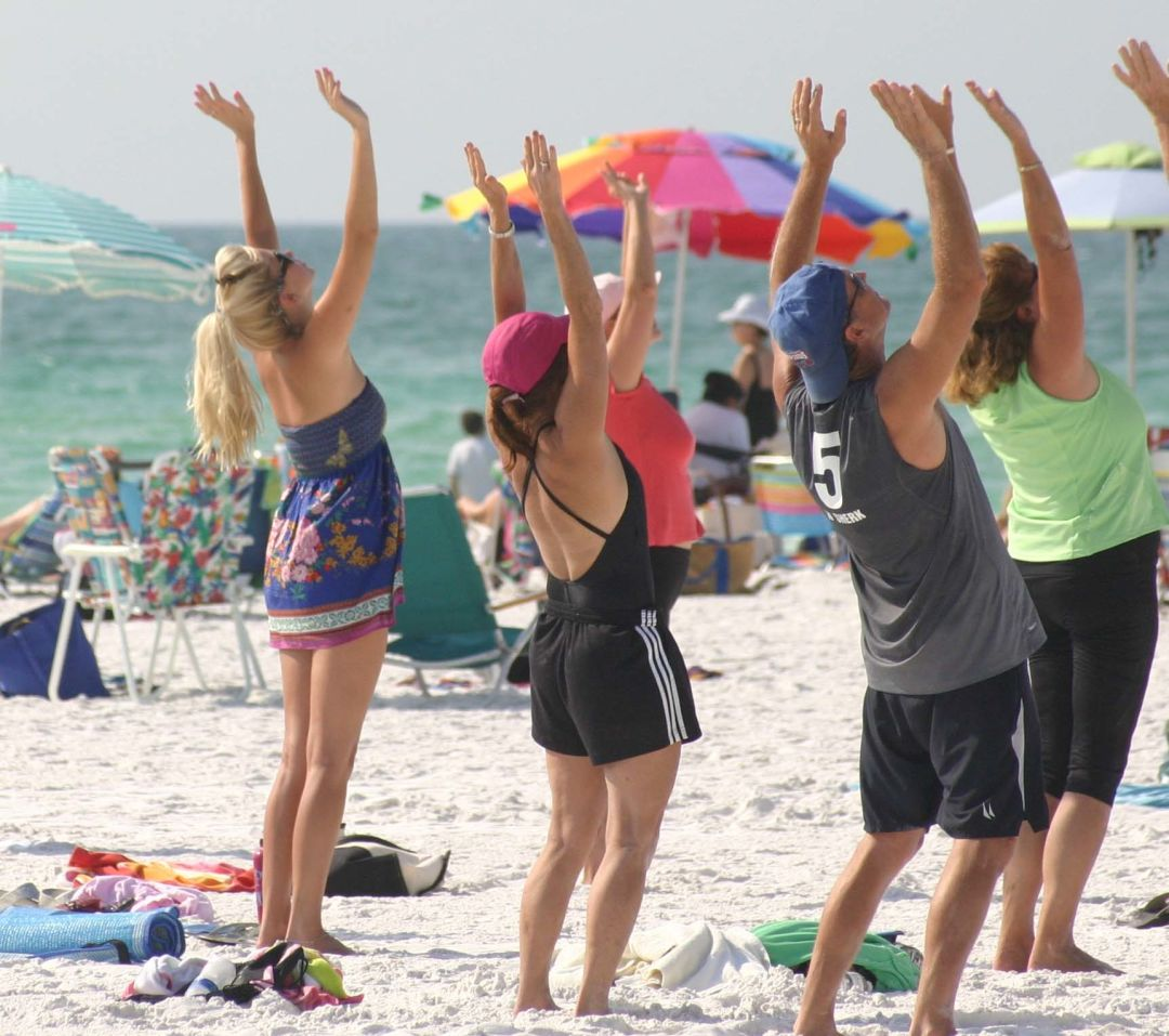 Standing yoga on the beach r8ehkv