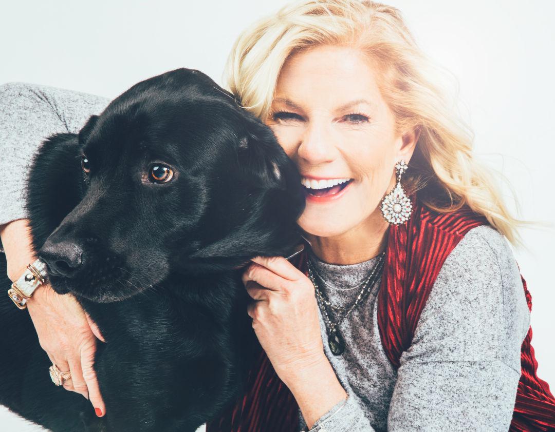 Laura McCann with Ian, her Labrador retriever.