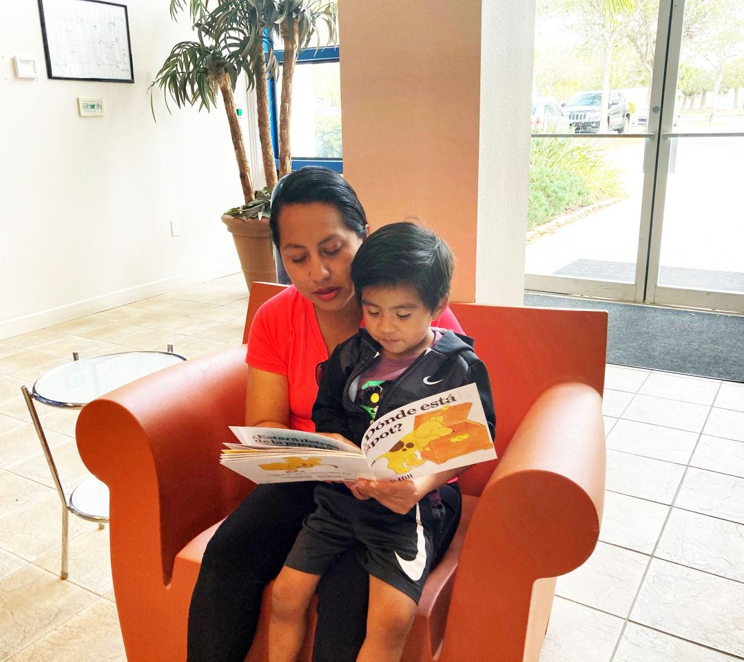 HIPPY mom Yulma Ruiz reads to her son, Milan Rosales