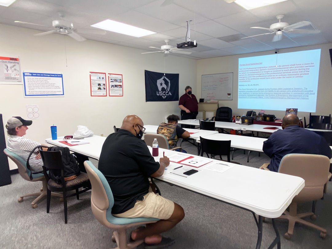 Community members currently participating in a security guard training class taught by Don Burrow (background, standing) include, from left to right, Jonathon Kikly, Sophia Wallace, Tyrone Cowan and Edmund Wilborn.