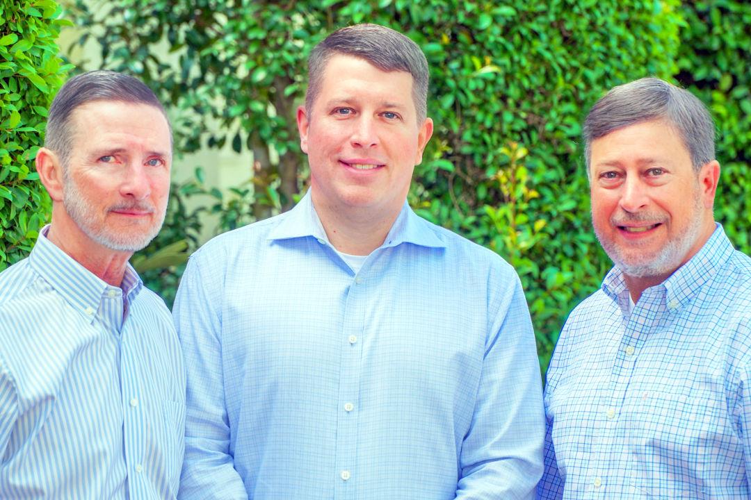 Goodwill Manasota CEO Bob Rosinsky, vice-president of operations Donn Githens and board chair Steve Boone