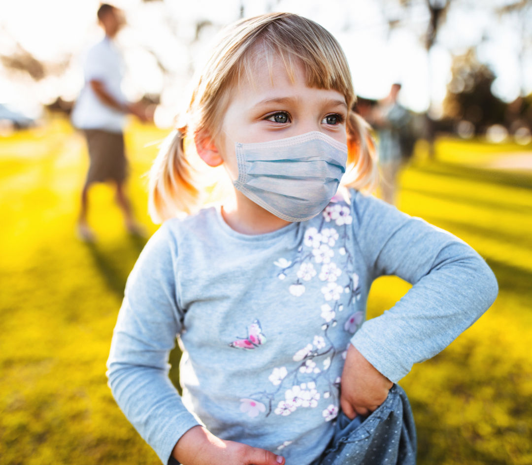 Small child wearing a protective mask