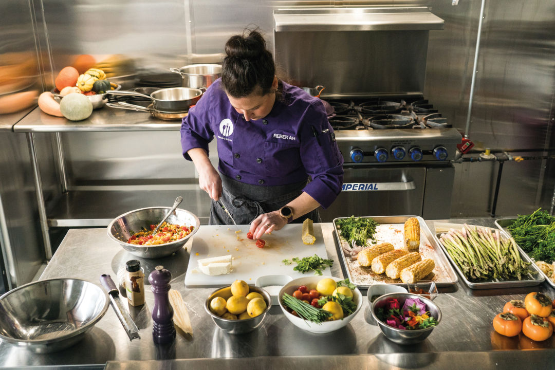 Chef Rebekah Abrams flexes her gourmet skills in her new kitchen facility.