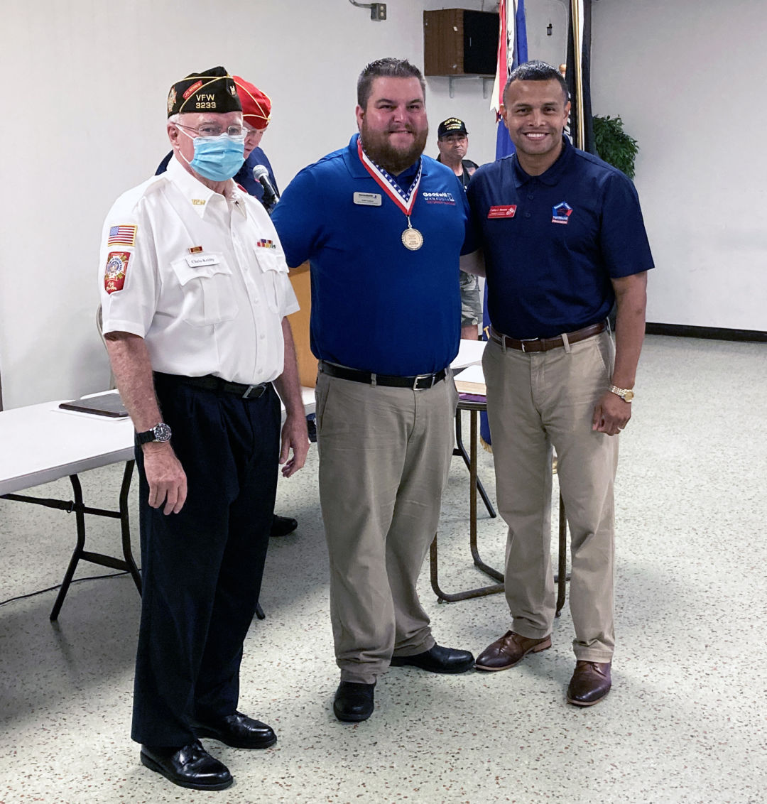 John H. McLain Veteran of the Year Award-winner Todd Hughes (center) with Christopher Kielty (left) and Carlos Moreira of the Sarasota County Veterans Commission