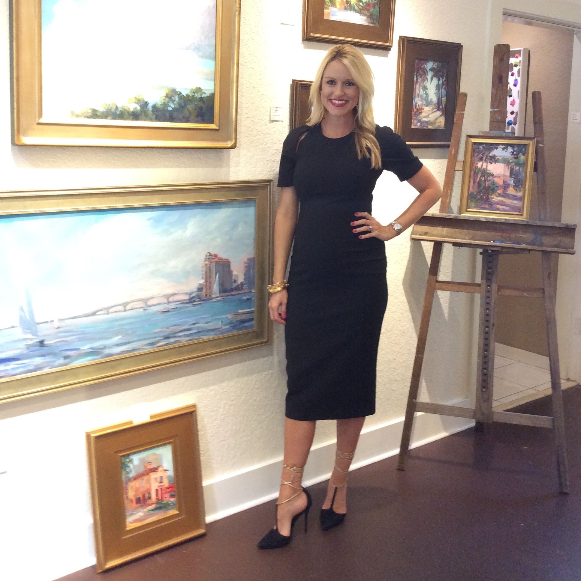 Montana in front of paintings by local artist linda richichi rrfm1x