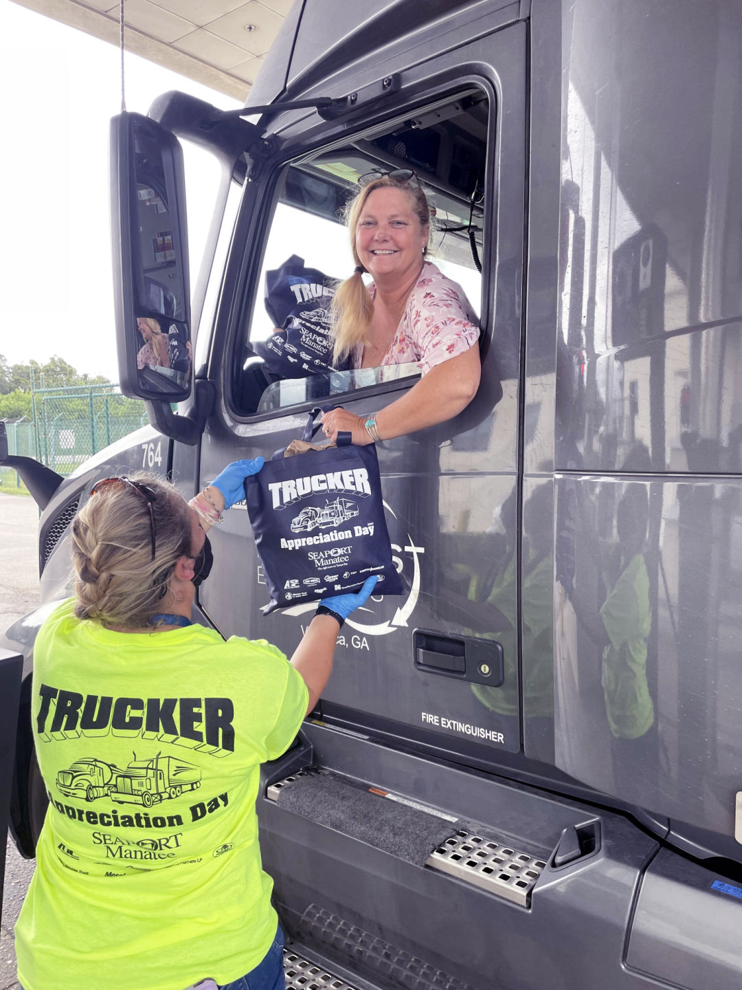 Lisa Rogers Orozco, who drives for Villa Rica, Georgia-based East-West Express Inc., smilingly accepts a goody bag as Port Manatee thanks professional drivers with its sixth annual Trucker Appreciation Day.