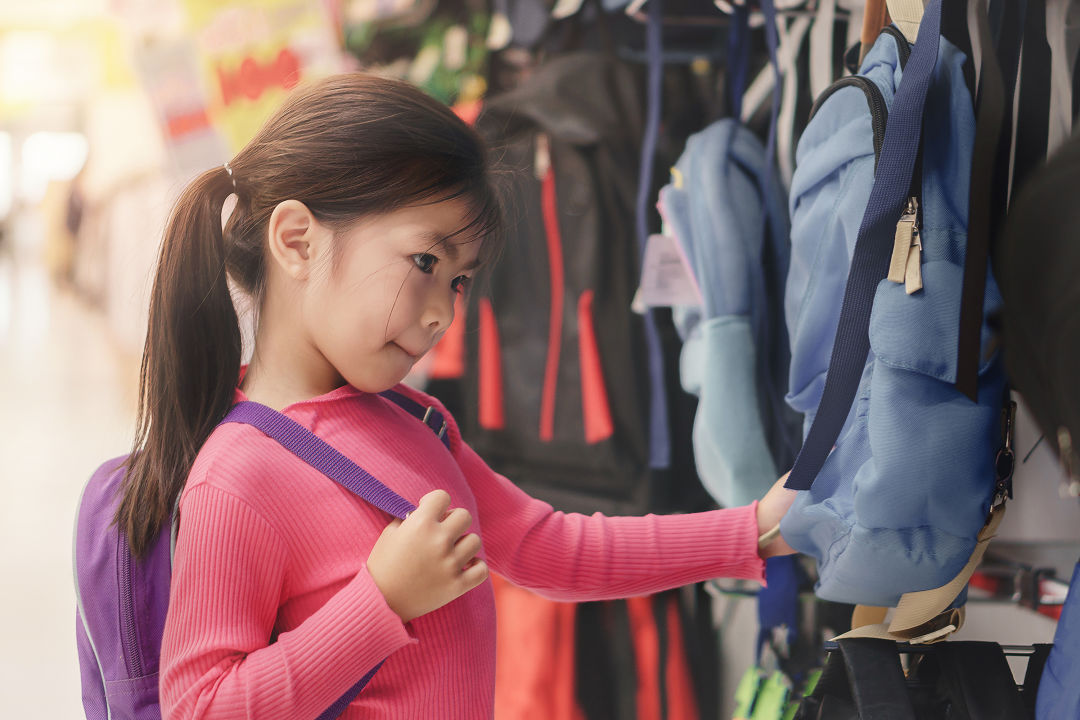 A young girl back-to-school shops.