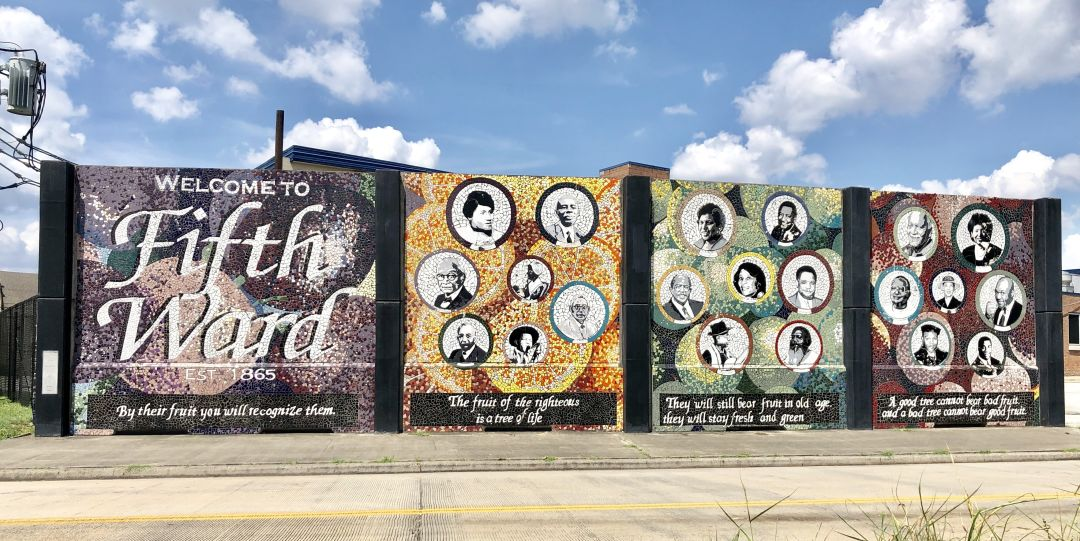 A mural of famous people from Houston's Fifth Ward