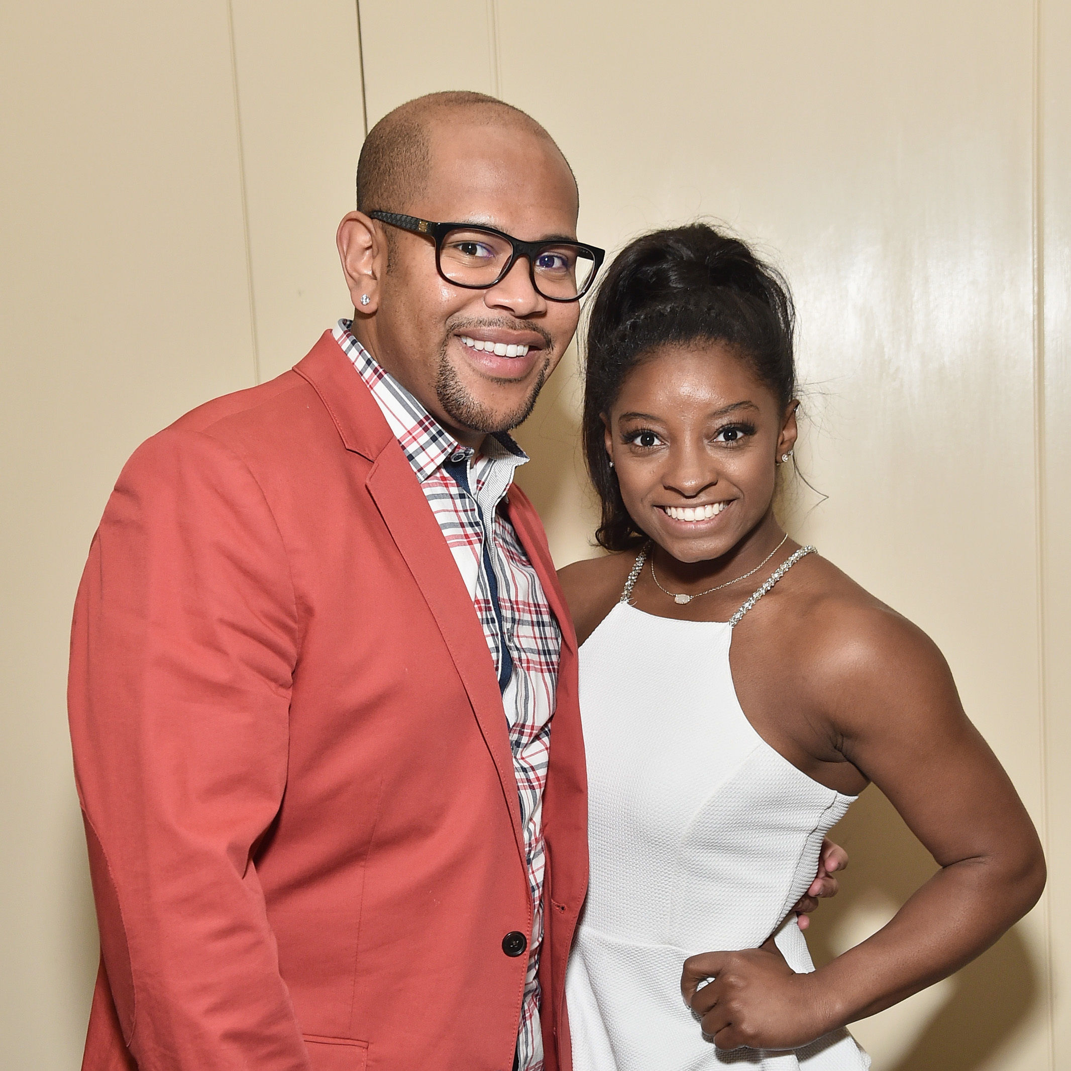 Olympic gymnast simone biles  r  and ron biles attend the  culinary kickoff at brennan s restaurant on february 2  2017 in houston  texas.  photo by mike coppolagetty images  2  ivoh2c
