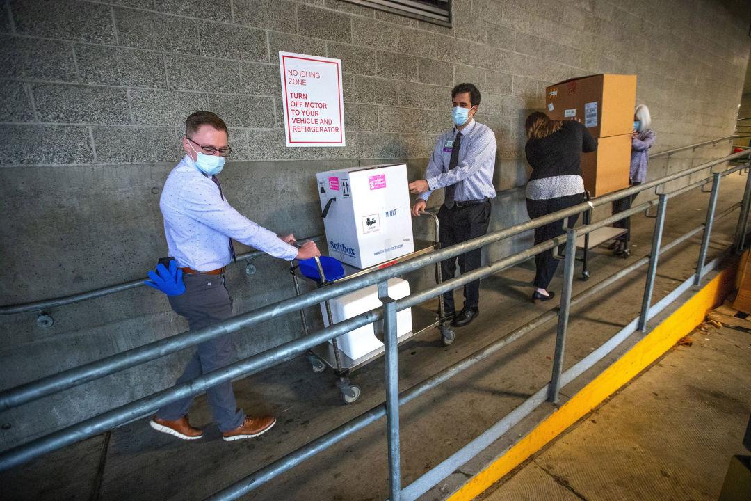 Workers carrying in coronavirus vaccine