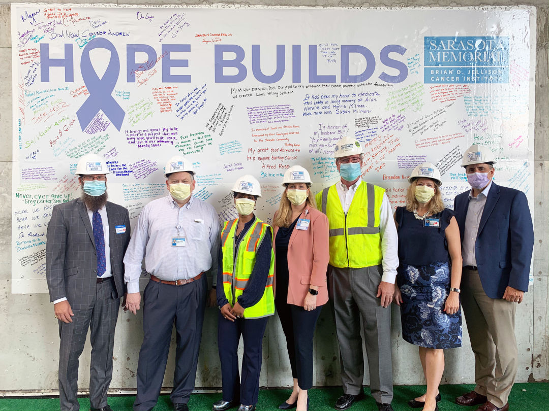 From left: Flad Architects principal Steve Jackson; SMH chief executive officer David Verinder; SMH cancer care services director Yulonda Green; SMH Cancer Institute director Kelly Batista; Brasfield & Gorrie Healthcare Division vice-president Peyton Robertson; SMH chief operating officer Lorrie Liang; and Sarasota Memorial Healthcare Foundation president Mason Ayres.