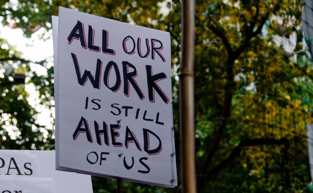 All Our Work Is Still Ahead of Us sign at Seattle protest after Joe Biden's election