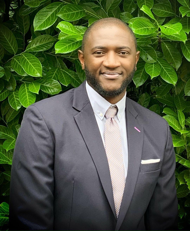 Solomon Alabi in a suit.