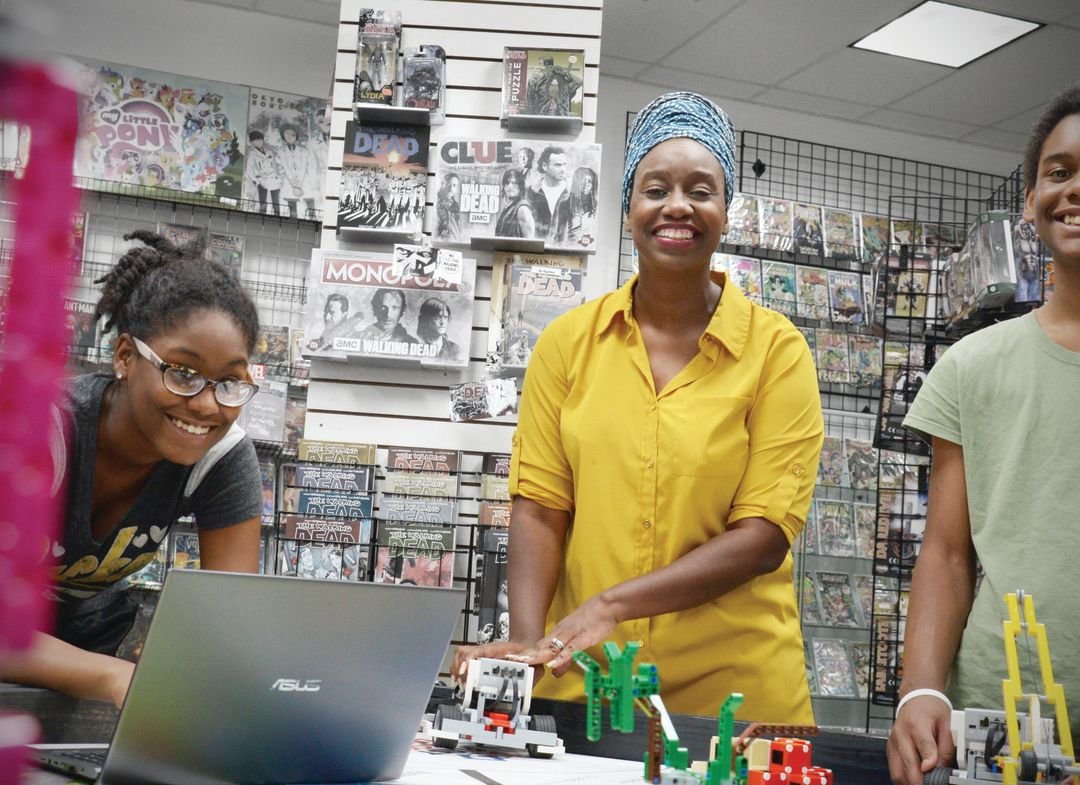 Neidra Lafontant, at right, with her neice, Niia Pierre Antoine, at Dark Side Comics.