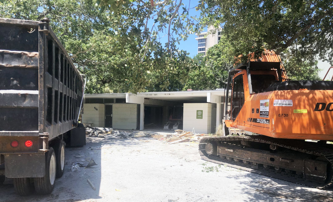 Demolition in progress child Protection Center's storage unit at 750 S. Orange Ave. in downtown Sarasota, which was deemed hazardous and was preventing the organization from expanding.