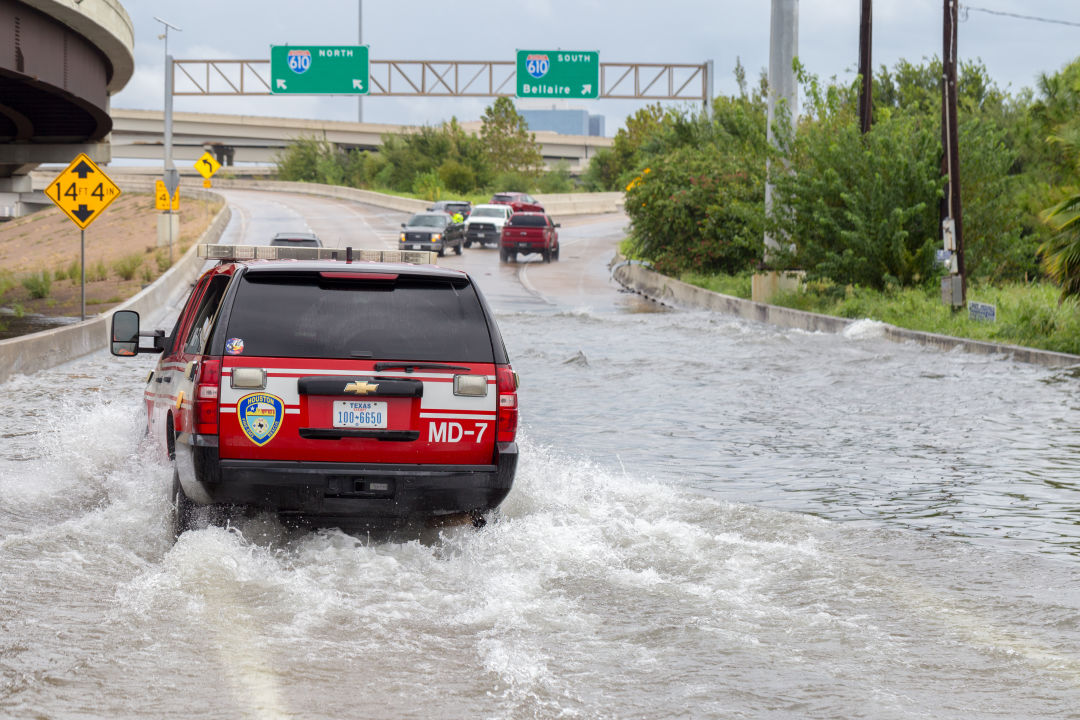 An emergency vehicle makes its way through floodwaters in Houston on August 27, 2017.