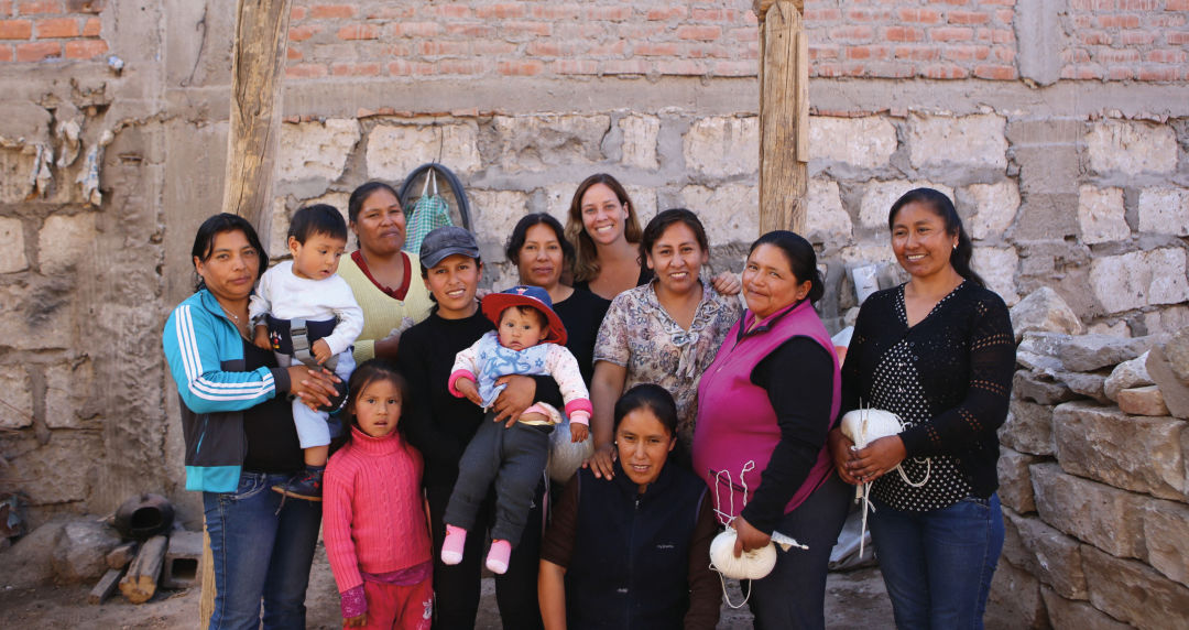Sien + Co founder Alex Gibson pictured with the women she works with in Peru