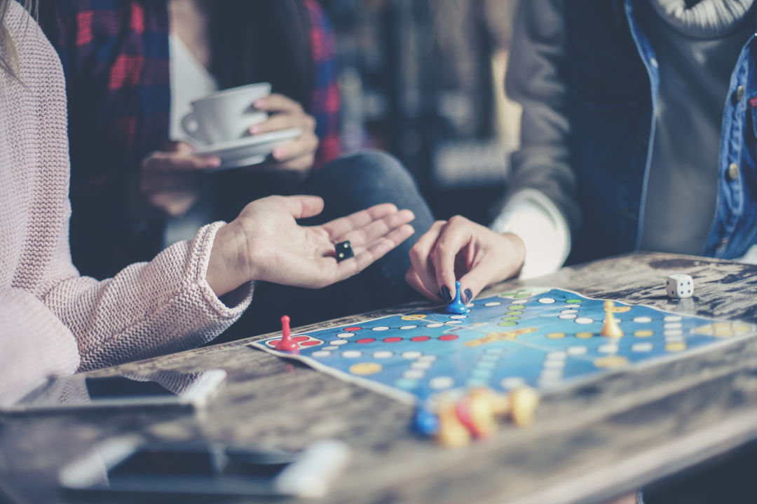"""""""The best thing about board games is that they are inclusive for all ages, from 4 to 104,"""" says Table Talk SRQ co-owner Desiree Ramey."""