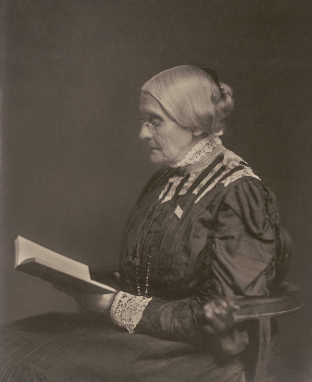 Susan B. Anthony reading a book circa 1900.
