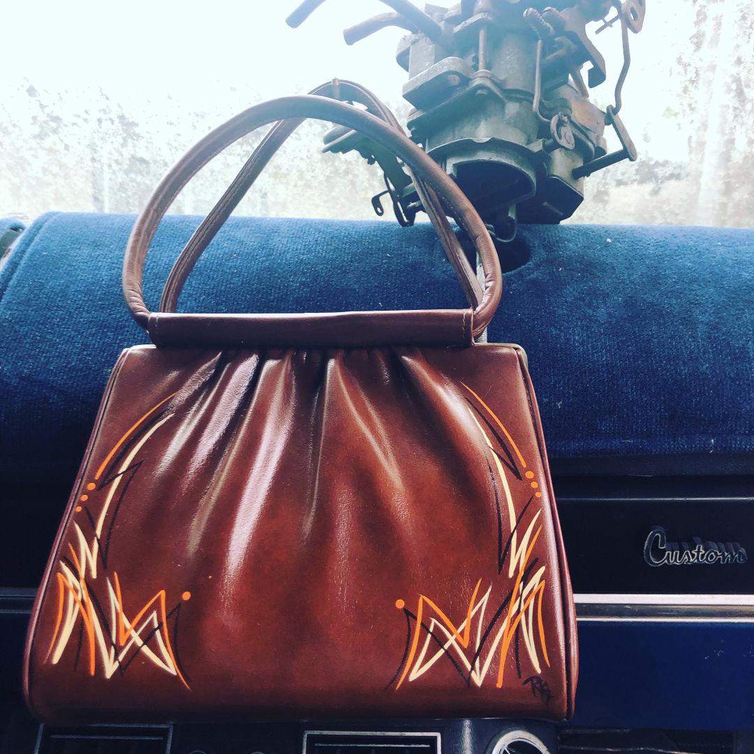 A purse that's been given the Tarably Stitched treatment.