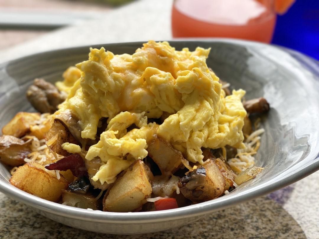 Breakfast Bowl of scrambled eggs and fried potatoes