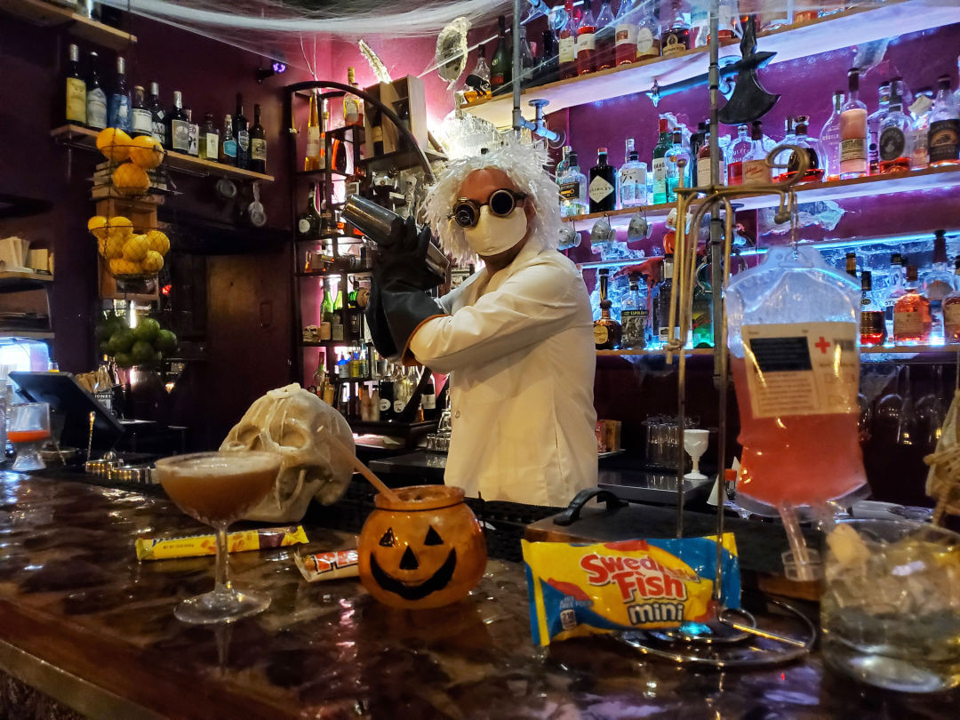 Panega Alchemy Lab owner Brad Coburn with his Halloween cocktail creations.
