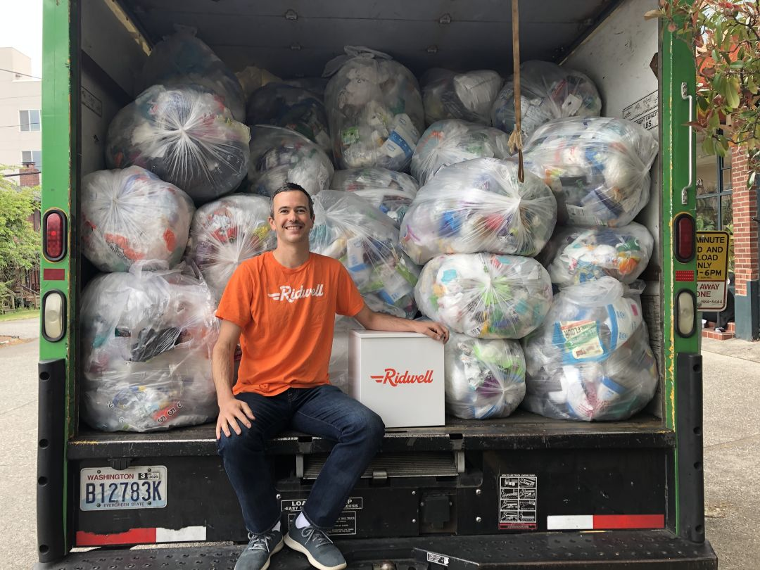 Ridwell cofounder and CEO Ryan Metzger in a truck