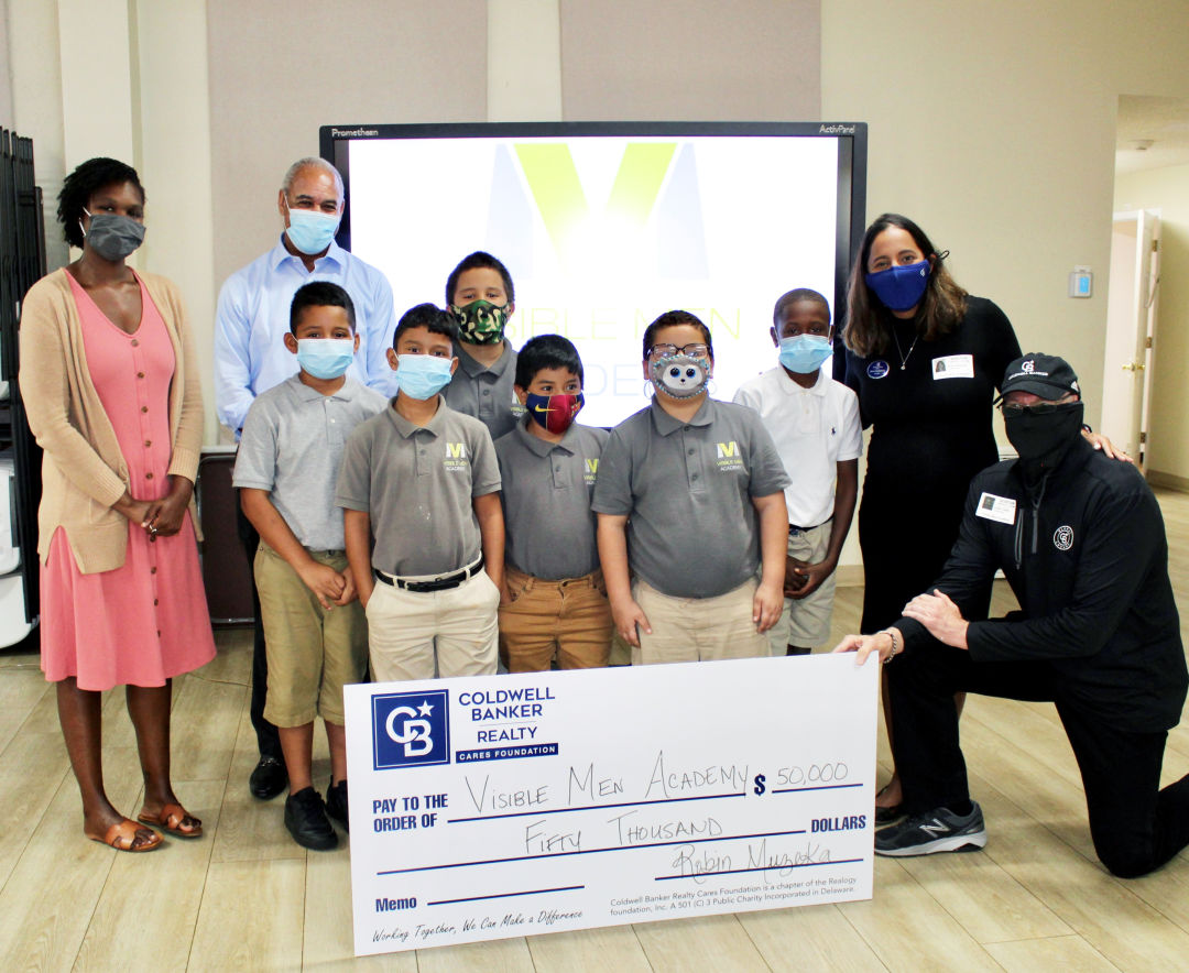 Former Coldwell Banker Realty president Clark Toole matched this donation through the Coldwell Banker Realty CARES and helped to present the $50,000 contribution to Visible Men Academy (VMA), on Aug. 25.