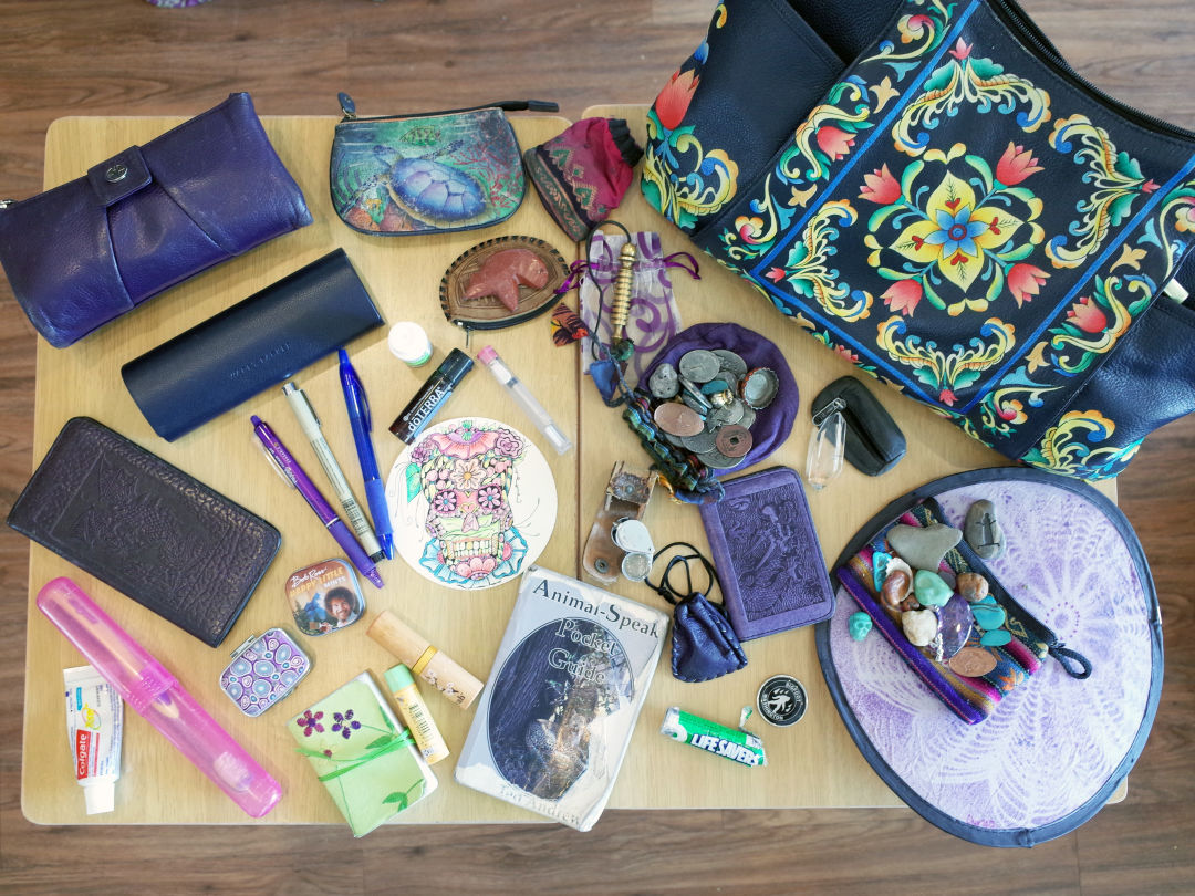 Moen's bag contains a variety of beloved items—including crystals, of course.