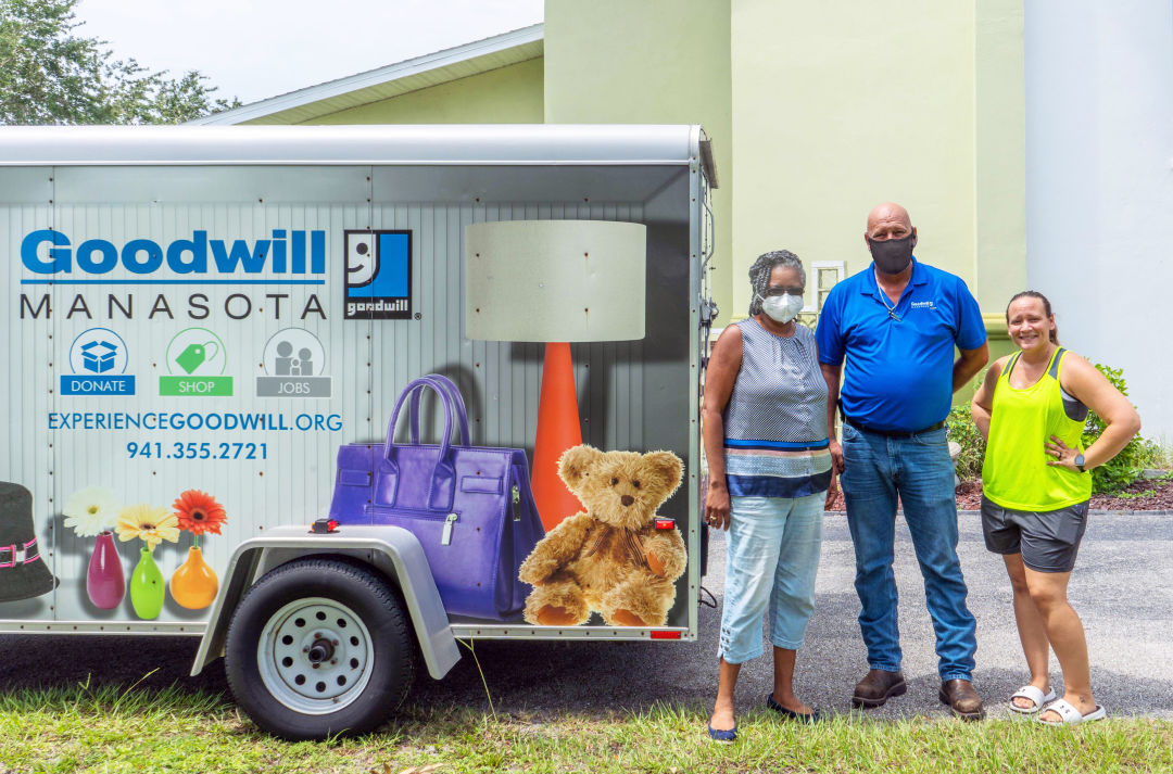 Faith United Methodist Church Pastor Tammie Isidore, Goodwill Manasota's Logistics Manager Russell Phillips, and church volunteer Michelle Millner load donated items bound for Haiti