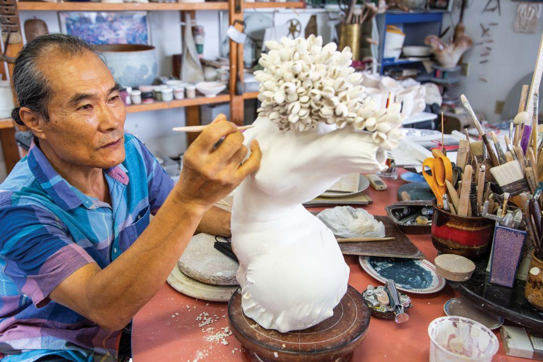 Ki Woon Huh in his studio