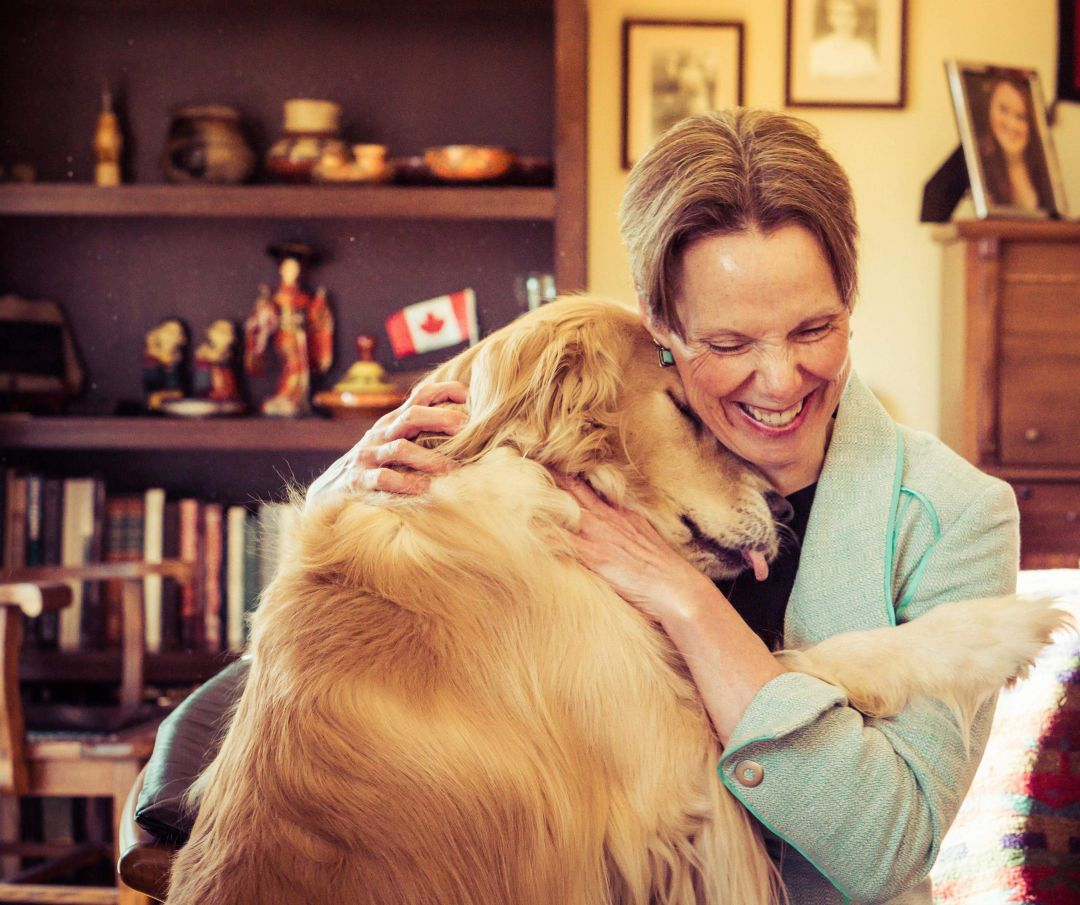 Dr. Patricia Okker with her dog, Blu.