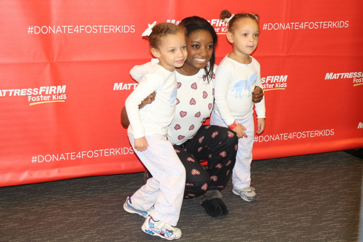 simone biles goes to the mattresses for foster kids houstonia