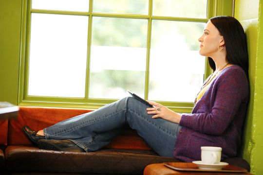 Woman sitting in a window seat