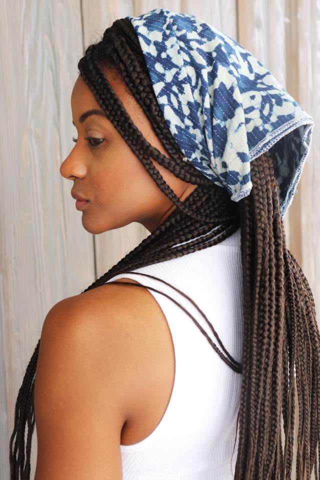 A woman models a Pondicheri scarf as a bandana.