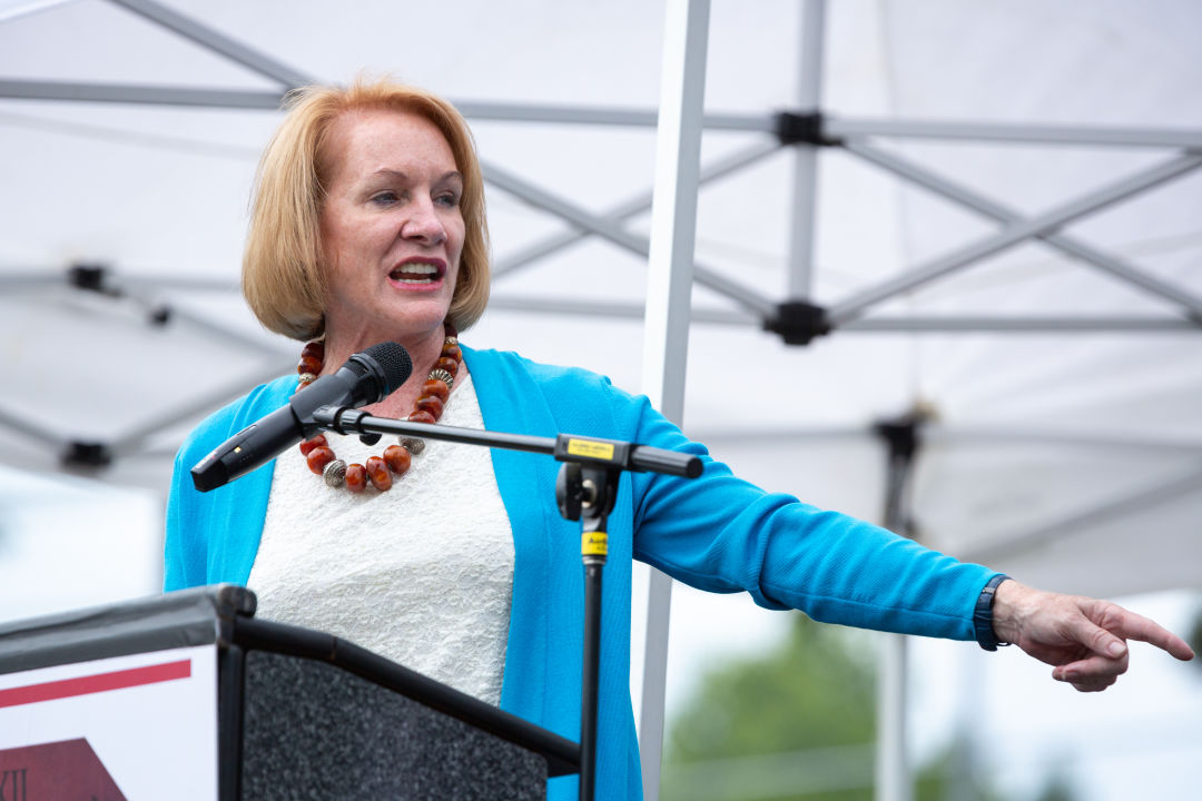 Jenny Durkan on a podium pointing