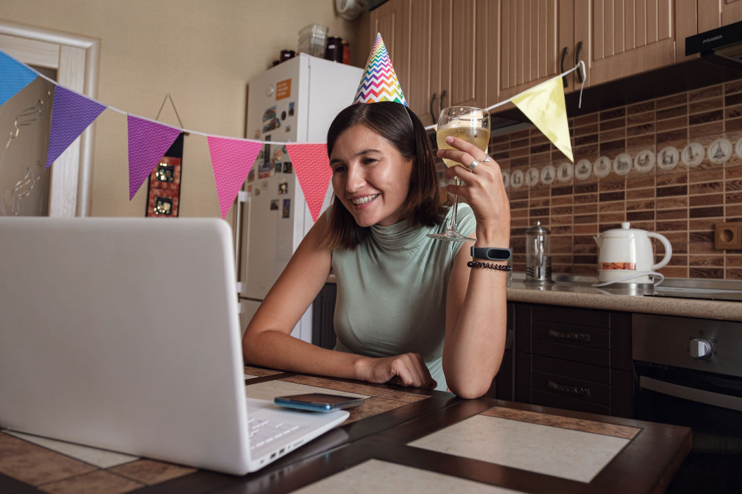 A woman attends a virtual party.