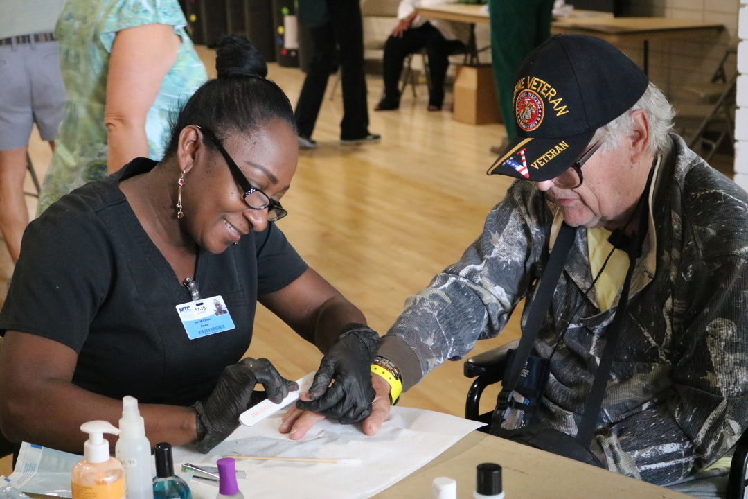 A homeless veteran receives assistance at a past Stand Down event.