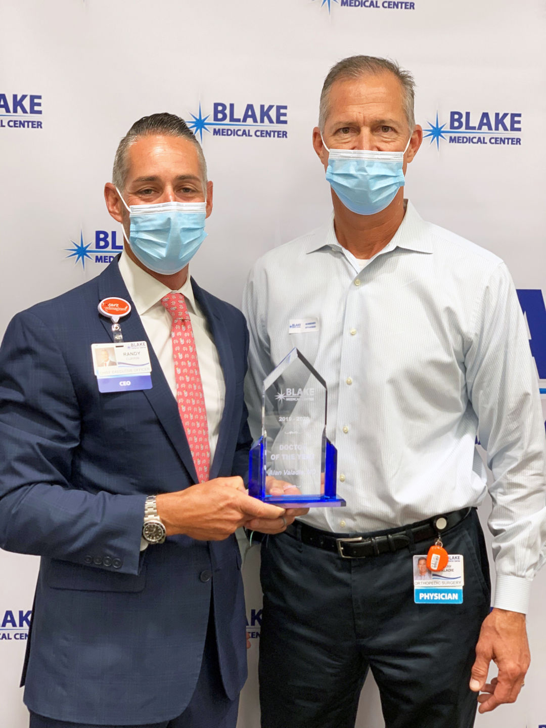 Randy Currin, president and chief executive officer of Blake Medical Center, presenting the award to Dr. Alan Valadie, joint replacement specialist and orthopedic surgeon with Coastal Orthopedics