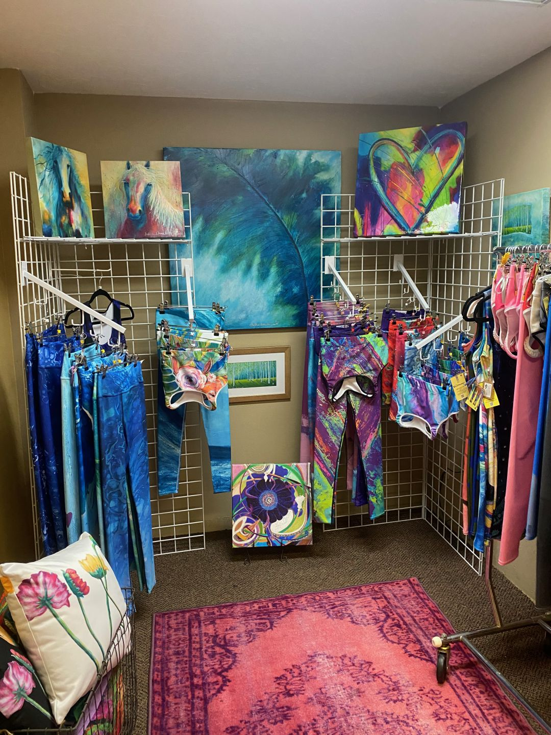 At the Threads boutique in downtown Sarasota, Debbie Dannheisser displays matching leggings and sports bras with their corresponding canvas.