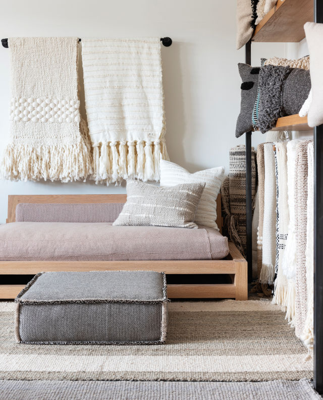 Handwoven throws, pillows, and floor cushions are among Sien + Co's offerings.